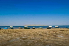Boats on the shore of the North Aral Sea in Tastubek village, Aral district
