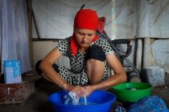 Sandugash Bilibaeva washes the family laundry