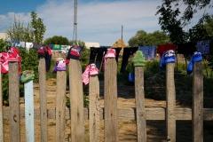 Children's socks drying in the sun in Birlik