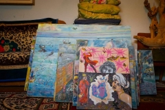 Paintings and collage by artist Anuarbek Saimbetov, evoking the desiccation of the Aral Sea and environmental precarity in Moynak