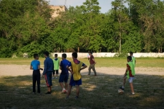 Teenagers attend soccer training on the town stadium