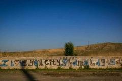 Graffiti on the Naryn river embankment